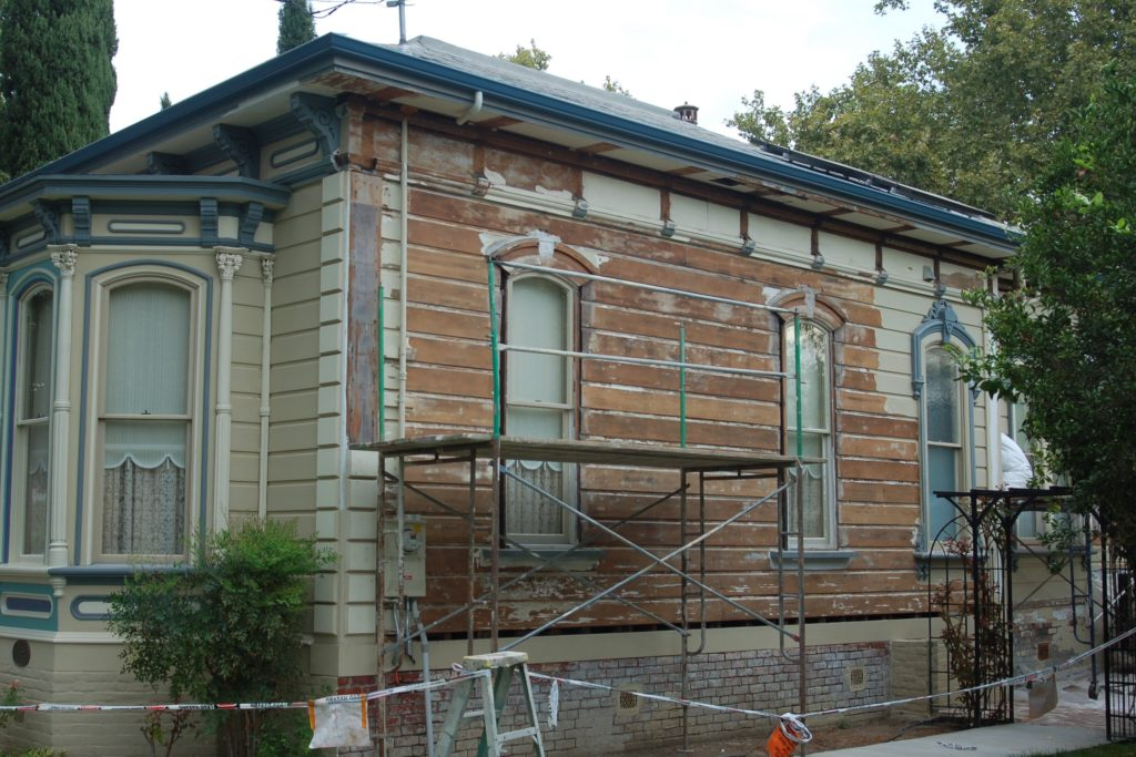 1876 Victorian house before painting and restoration in Woodland CA